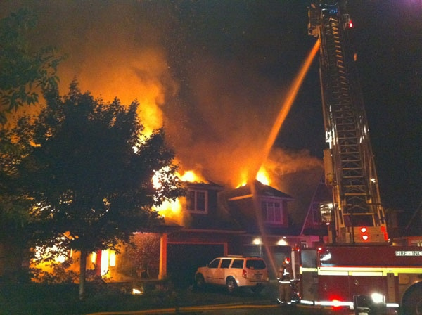 Fire crews try to put out a massive house fire on Creekwood Crescent in Ottawa's Crystal Beach neighbourhood, Wednesday, July 20, 2011. Viewer photo submitted by: Robert Lacasse