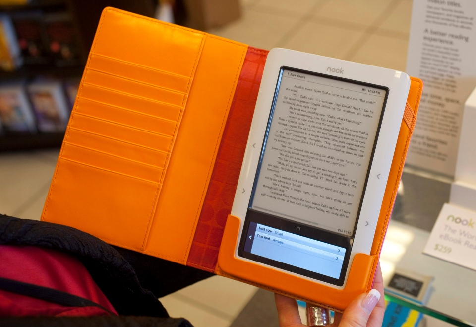 In this Feb. 9, 2010 file photo, a customer reads a Nook electronic reader at a Barnes & Noble book store in Hackensack, N.J. (AP Photo/Mark Lennihan, file)