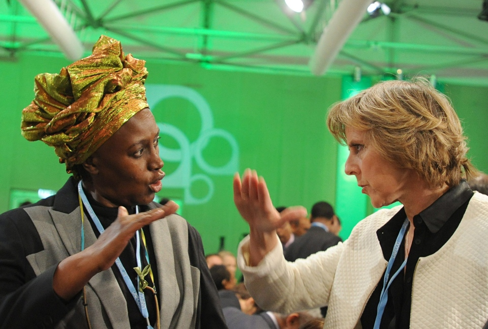 EU Commisioner for Climate Action Connie Hedegaard, right, talks with Alice Akinyi Kaudia from Kenya prior to the opening of the High-level Segment of th UN Climate Change Conference in Warsaw, Poland, Tuesday, Nov. 19, 2013. (AP / Alik Keplicz)