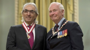 Governor General David Johnston invests Phil Fontaine as an Officer of the Order of Canada during a ceremony at Rideau Hall Friday November 22, 2013 in Ottawa. THE CANADIAN PRESS/Adrian Wyld