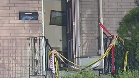 Yellow tape blocks the door to a home that caught fire on Lexington Street, Wednesday, July 20, 2011. Courtesy: TVA