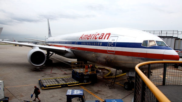 An American Airlines plane is parked at the terminal at O'hare International airport in Chicago, Wednesday, July 20, 2011. (AP / Robert Ray)