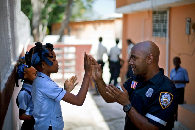 community policing essays Community policing is defined as any method of policing that includes a police officer assigned to the same area, meeting and working with the residents and.