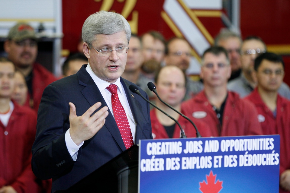Prime Minister Stephen Harper announces the opening of the first section of the new CentrePort Canada Way expressway at Fort Garry Fire Trucks in Winnipeg, Friday, November 22, 2013. (John Woods  / THE CANADIAN PRESS)