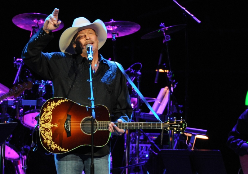 Alan Jackson performs at the George Jones Tribute - Playin' Possum: The Final No Show, on Friday, Nov. 22, 2013 at the Bridgestone Arena in Nashville, Tenn. (Photo by Frank Micelotta/Invision/AP)