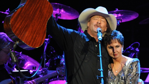 Alan Jackson with Nancy Jones, widow of the late George Jones, at the George Jones Tribute - Playin' Possum: The Final No Show, on Friday, Nov. 22, 2013 at the Bridgestone Arena in Nashville, Tenn. (Photo by Frank Micelotta / Invision / AP)
