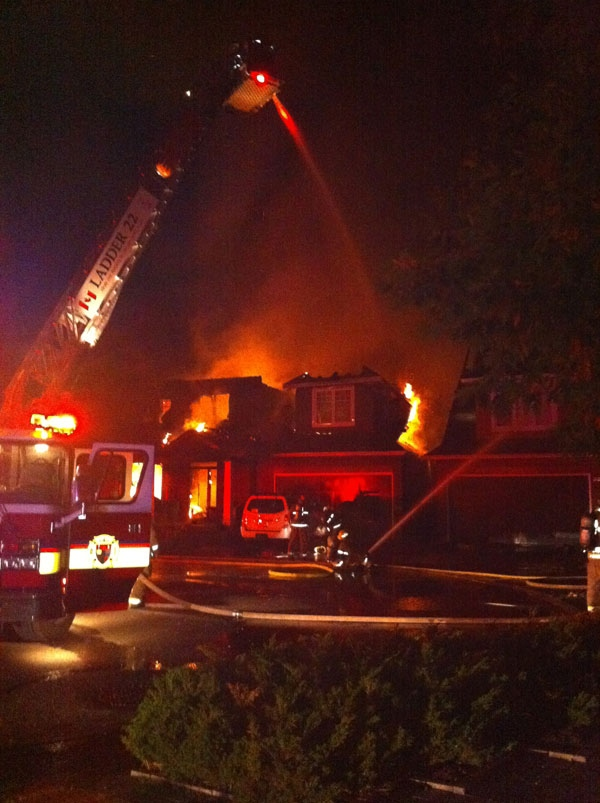 Firefighters battle a blaze that damaged three homes on Creekwood Crescent in Ottawa's west end, Wednesday, July 20, 2011. Viewer photo submitted by: Robert Lacasse