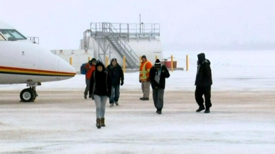 Attawapiskat First Nation community evacuees arrive in Kapuskasing, Ont., Saturday, Nov. 23, 2013.