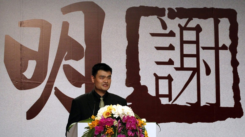 NBA star Yao Ming delivers a speech confirming his retirement from professional basketball in Shanghai, China, Wednesday, July 20, 2011. (AP Photo/Eugene Hoshiko)