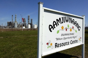 A sign for the Aamjiwnaang First Nation Resource Centre is located across the road from NOVA Chemicals in Sarnia, Ont., on April 21, 2007. A new study has shed light on the health problems facing a First Nations community living near one of Canada's most industrialized areas. (Craig Glover / THE CANADIAN PRESS)