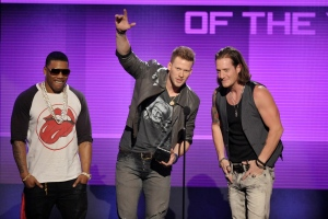 From right, Tyler Hubbard and Brian Kelley of the musical group Florida Georgia Line, and Nelly accept the award for single of the year for 'Cruise' at the American Music Awards at the Nokia Theatre L.A. Live on Sunday, Nov. 24, 2013. (John Shearer / Invision)