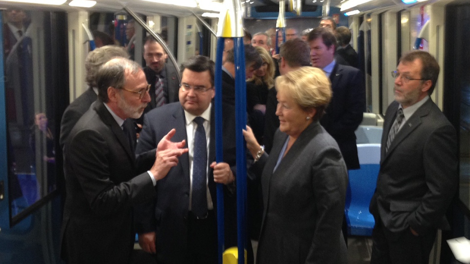 Montreal mayor Denis Coderre and Premier Pauline Marois aboard one of the new Azur metro cars (CTV Montreal/Max Harrold)