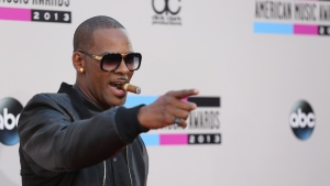 R Kelly arrives at the 2013 American Music Awards, in Los Angeles on Sunday, Nov. 24, 2013. (Matt Sayles/Invision)