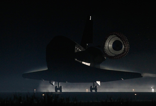 Space shuttle Atlantis lands at the Kennedy Space Center at Cape Canaveral, Fla. Thursday, July 21, 2011. The landing of Atlantis marks the end of NASA's 30 year space shuttle program. (AP / Terry Renna)