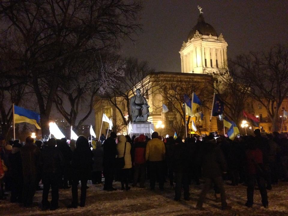 Manitobans with ties to Ukraine gather at the Taras Shevchenko monument on the Manitoba Legislative Grounds Monday evening.