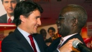 Liberal Leader Justin Trudeau, left, congratulates Emmanuel Dubourg in Montreal Monday, November 25, 2013 following Dubourg's win in the federal byelection for the riding of Bourassa. (Graham Hughes / THE CANADIAN PRESS)