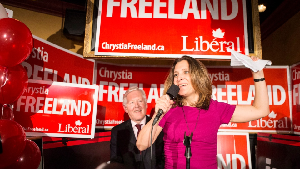 Liberal Candidate Chrystia Freeland (right) stands with Bob Rae as she celebrates after winning the Toronto Centre Federal byelection in Toronto on Monday November 25, 2013. (Chris Young / THE CANADIAN PRESS)