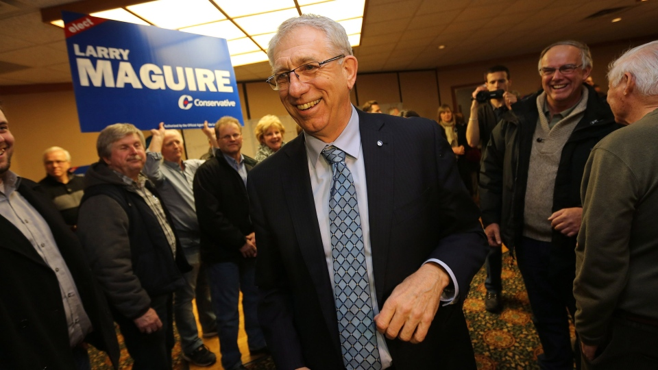 Conservative candidate Larry Maguire enters his victory party following a tight byelection in the Brandon-Souris area in Brandon, Man., Monday night, Nov. 25, 2013. (Trevor Hagan / THE CANADIAN PRESS)