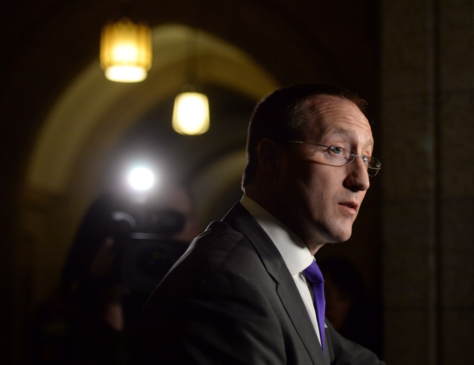 Peter MacKay, Minister of Justice and Attorney General of Canada, takes part in a press conference in the House of Commons foyer on Parliament Hill in Ottawa on Monday, Nov. 25, 2013. (Sean Kilpatrick / THE CANADIAN PRESS)