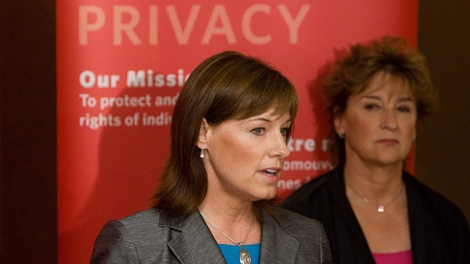 Privacy Commissioner of Canada, Jennifer Stoddart, right, looks on as her Assistant Privacy Commissioner of Canada, Elizabeth Denham, speaks during a press conference in Ottawa on Thursday July 16, 2009, following the release of a report of findings by the Privacy Commissioner of Canada looking into Facebook's privacy practices. (CP/Sean Kilpatrick)