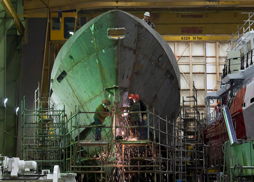 Technicians work on a hull at Halifax Shipyard in Halifax on Thursday, March 7, 2013 after Ottawa signed a $288 million contract for the design of new Arctic offshore patrol ships as part of its shipbuilding procurement project. (Andrew Vaughan / THE CANADIAN PRESS)
