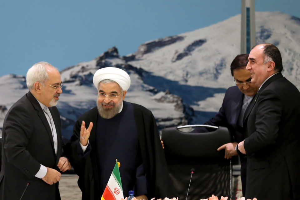 From left to right Mohammad Javad Zarif, Iran's foreign minister, Hassan Rouhani, Iran's president, and Elmar Mammadyarov, Azerbaijan's foreign minister attend the ECO council of ministers in Tehran, Iran on Tuesday, Nov. 26, 2013. (AP / Ebrahim Noroozi)
