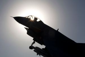 A Chinese-made fighter jet is silhouetted against the sun in Beijing, China, Wednesday, Nov. 27, 2013. (AP / Ng Han Guan)