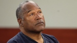 This May 13, 2013 file photo shows O.J. Simpson listening to testimony at an evidentiary hearing in Clark County District Court in Las Vegas. (AP Photo/Julie Jacobson, Pool, File)