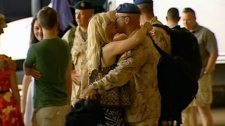 Canadian soldiers return home to their families at Ottawa International Airport, Friday, July 22, 2011.