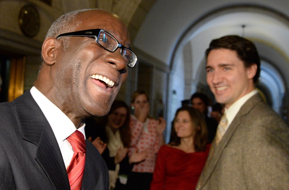Liberal Leader Justin Trudeau, right, stands with newly elected members Emmanuel Dubourg, left, and Chrystia Freeland, middle, as they are welcomed by the Liberal caucus on Parliament Hill in Ottawa on Wednesday, Nov. 27, 2013. (Sean Kilpatrick / THE CANADIAN PRESS)