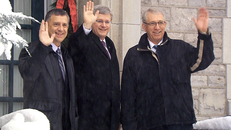 Prime Minister Stephen Harper, centre, waves with Conservative MPs Ted Falk, left, and Larry McGuire, right, at 24 Sussex Drive in Ottawa, Wednesday, Nov. 27, 2013.