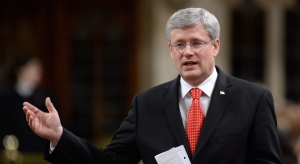 Prime Minister Stephen Harper responds to a question during question period in the House of Commons on Parliament Hill in Ottawa on Tuesday, Nov. 26, 2013. (Sean Kilpatrick / THE CANADIAN PRESS)