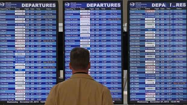 A departures board at Denver International Airport