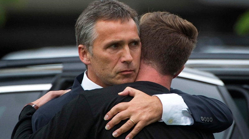 Norway's Prime Minister Jens Stoltenberg, left, embraces the leader of the Labour party's youth group Eskild Pedersen who was on the island during the shooting attacks at Stoltenberg visited survivors at a hotel in Sundvolden, Norway, Saturday, July 23, 2011. (AP Photo)