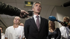Norwegian Prime Minister Jens Stoltenberg, centre, is flanked by an unidentified doctor during a press briefing at the Ulleval University hospital in Olso, Norway Saturday July 23, 2011. (AP Photo/Scanpix/Aleksander Andersen)