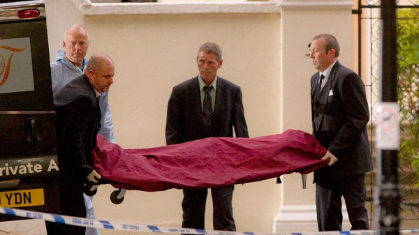 A body, believed to be that of singer Amy Winehouse, is removed from her home following her death, in north London, Saturday, July 23, 2011. (AP / Joel Ryan)