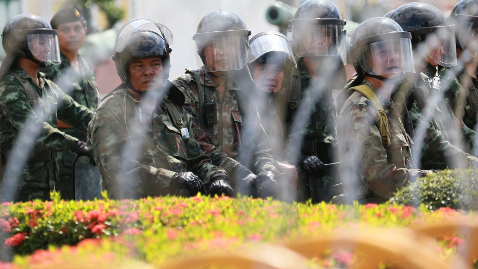 Thai soldiers stand guard at Defense Ministry where anti-government protesters gather in Bangkok, Thailand on Thursday, Nov. 28, 2013. (AP / Wason Wanichakorn)