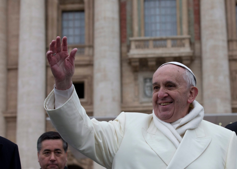 Pope Francis waves to faithful at the end of his weekly general audience in St. Peter's Square at the Vatican, Wednesday, Nov. 27, 2013. (AP / Alessandra Tarantino)