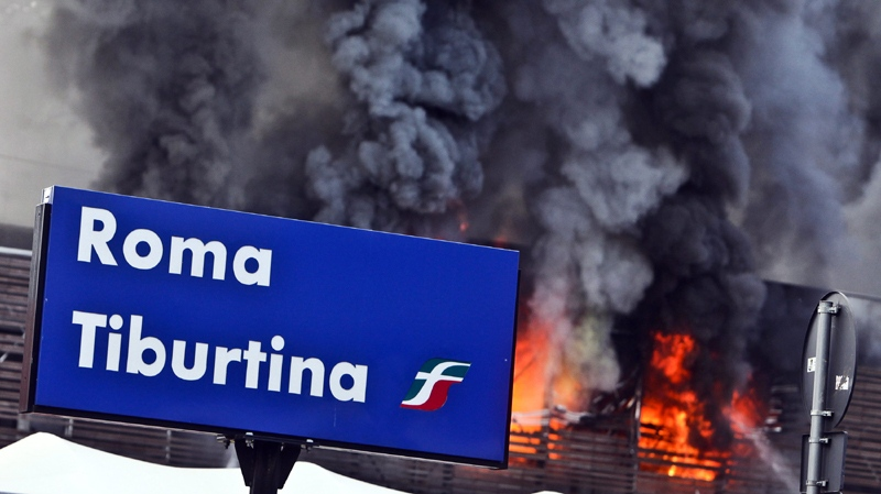 Flames spread at Tiburtina station, one of Rome's railway stations, Sunday July 24, 2011.
