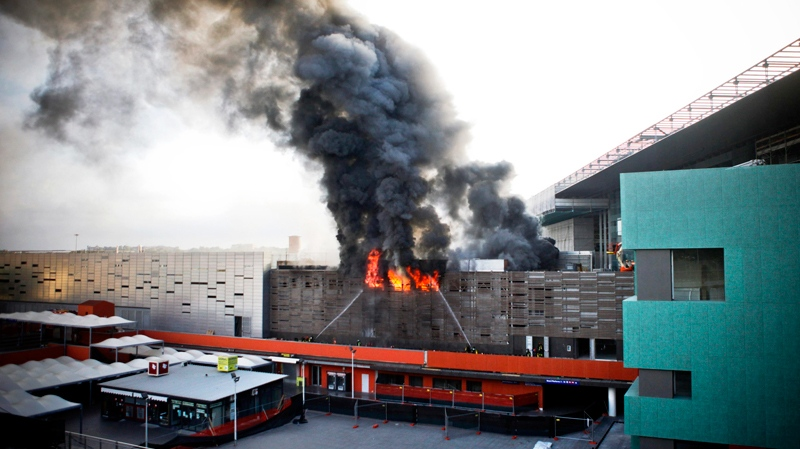 Firefighters try to estinguish flames at Tiburtina station, one of Rome's railway stations, Sunday July 24, 2011. (AP / Angelo Carconi)