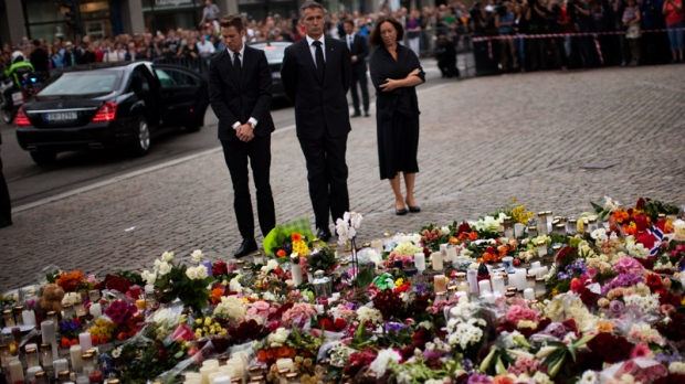Norway's Prime Minister Jens Stoltenberg, center, pays tribute to victims of the twin attacks before a memorial service at Oslo Cathedral, Sunday, July 24, 2011. (AP / Emilio Morenatti)