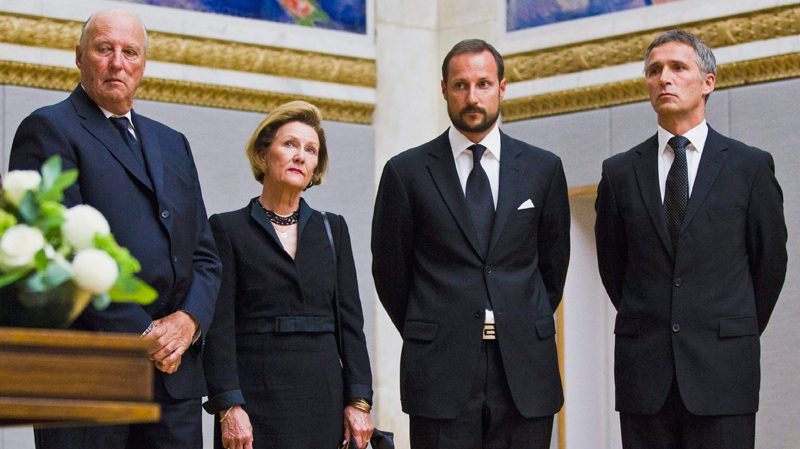 From left: King Harald, Queen Sonja, Crown Prince Haakon and Norwegian Prime Minister Jens Stoltenberg stand during a ceremony to sign a protocol of condolence for the victims of Friday's atrocities in Oslo and on the Utoya island, in the Grand Hall of Oslo University, Oslo, Monday, July 25, 2011. (Scanpix Norway / Vegard Groett)