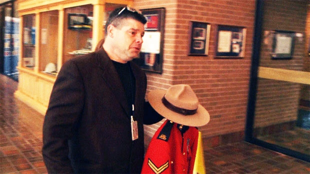 RCMP Cpl. Ron Francis arrives at RCMP J-Division headquarters in Fredericton to hand over his red serge uniform on Nov. 29, 2013.