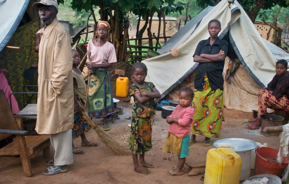 A family who fled recent violence stand by their makeshift tents at a camp for the internally-displaced in the town of Bouca, Central African Republic in this photo taken Tuesday, Nov. 26, 2013. (AP / Florence Richard)