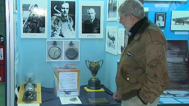 """Denny May takes a final look at the City Centre Airport's display about his father, Wilfrid Reid """"Wop"""" May, who was instrumental in starting the airfield."""