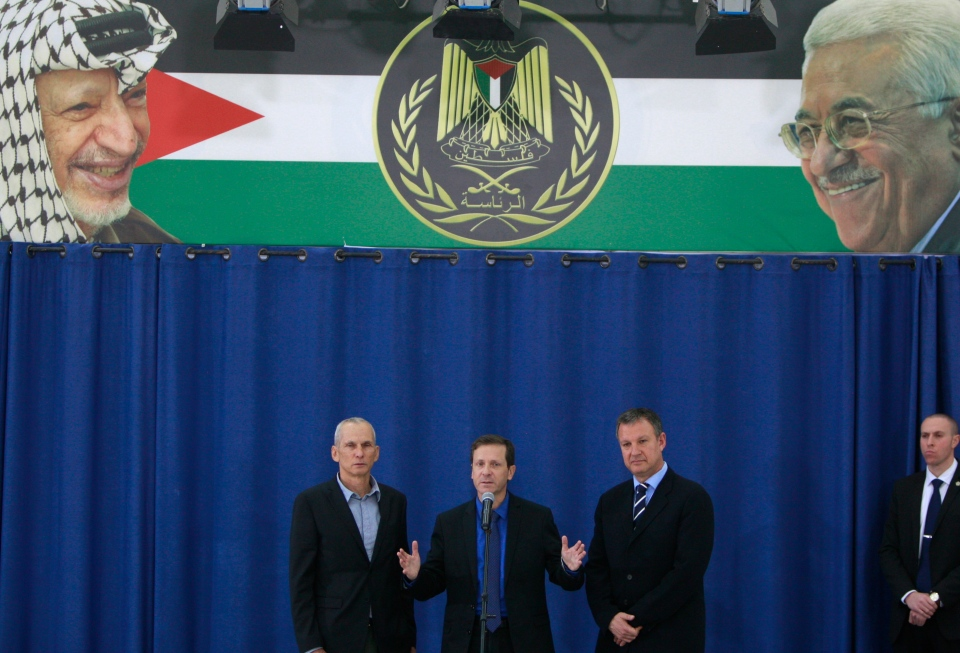 Israeli new labor party leader Isaac Herzog speaks during a press conference flanked by his party officials Erel Margalit, right, and Omer Bar-Lev after their meeting with Palestinian President Mahmoud Abbas in the West Bank city of Ramallah, Sunday, Dec. 1, 2013. (AP / Majdi Mohammed)