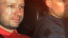 Norway's twin terror attacks suspect Anders Behring Breivik, left, sits in an armoured police vehicle after leaving the courthouse following a hearing in Oslo, Monday, July 25, 2011. (Aftenposten / Jon-Are Berg-Jacobsen)