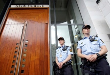 Police officers guard the court entrance in Oslo, Norway, Monday, July 25, 2011. (AP / Frank Augstein)