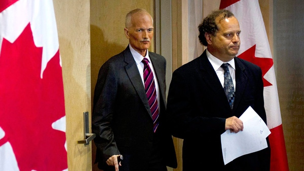 NDP Leader Jack Layton, left, arrives at a news conference with party president Brian Topp, in Toronto on Monday, July 25, 2011. (Nathan Denette / THE CANADIAN PRESS)