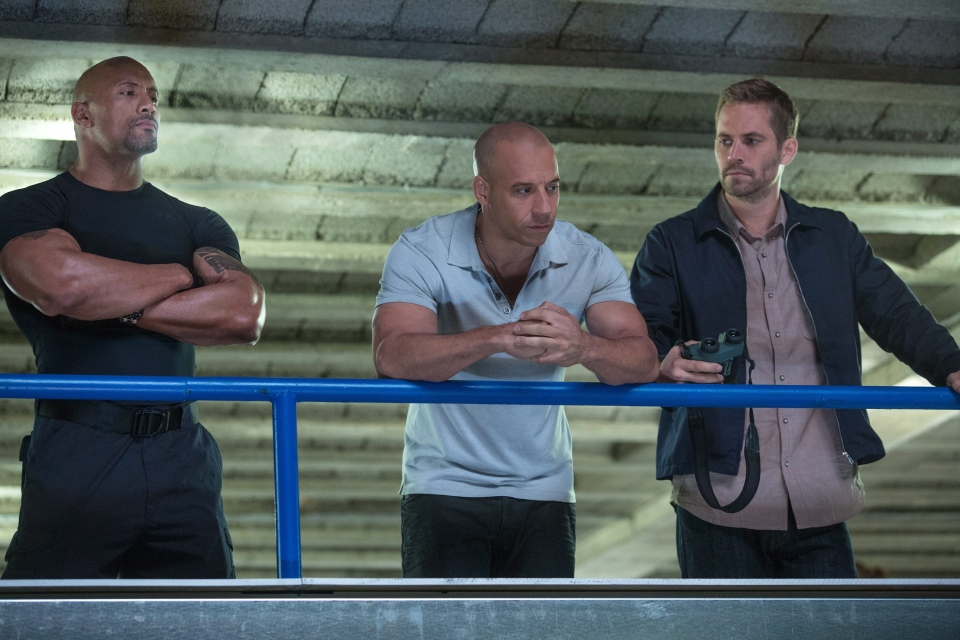 Dwayne Johnson, Vin Diesel, and Paul Walker in Universal Pictures' 'Fast & Furious 6'